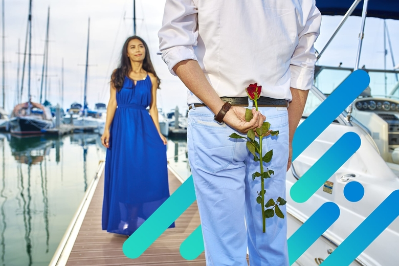 Woman walking towards man with flowers behind his back