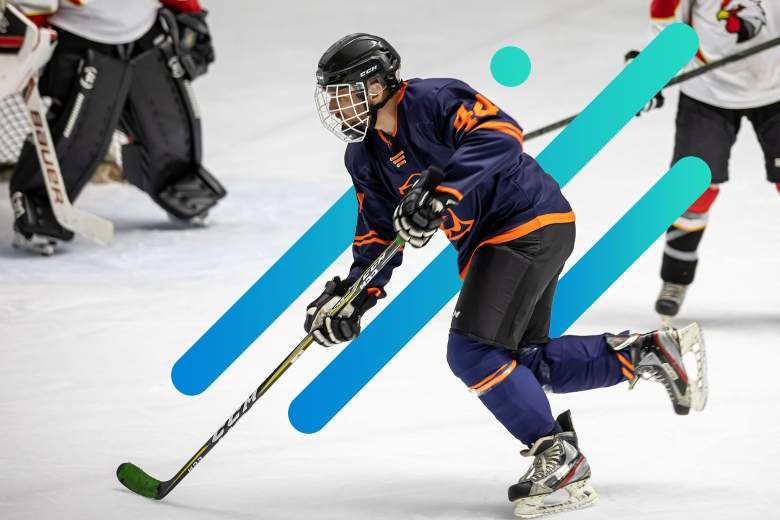 ice hockey player skating on the ice with an abstract background