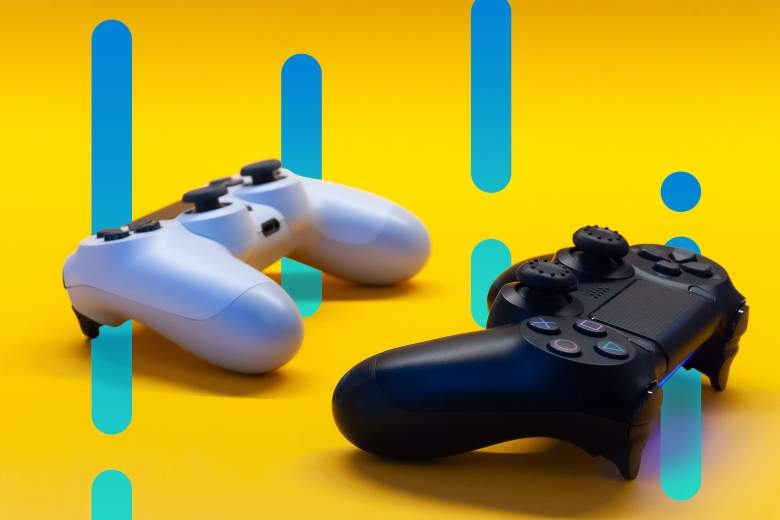 two video game controllers with an abstract background