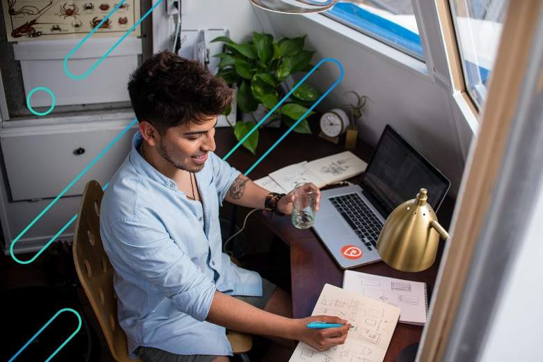 college student studying at his deck in his dorm