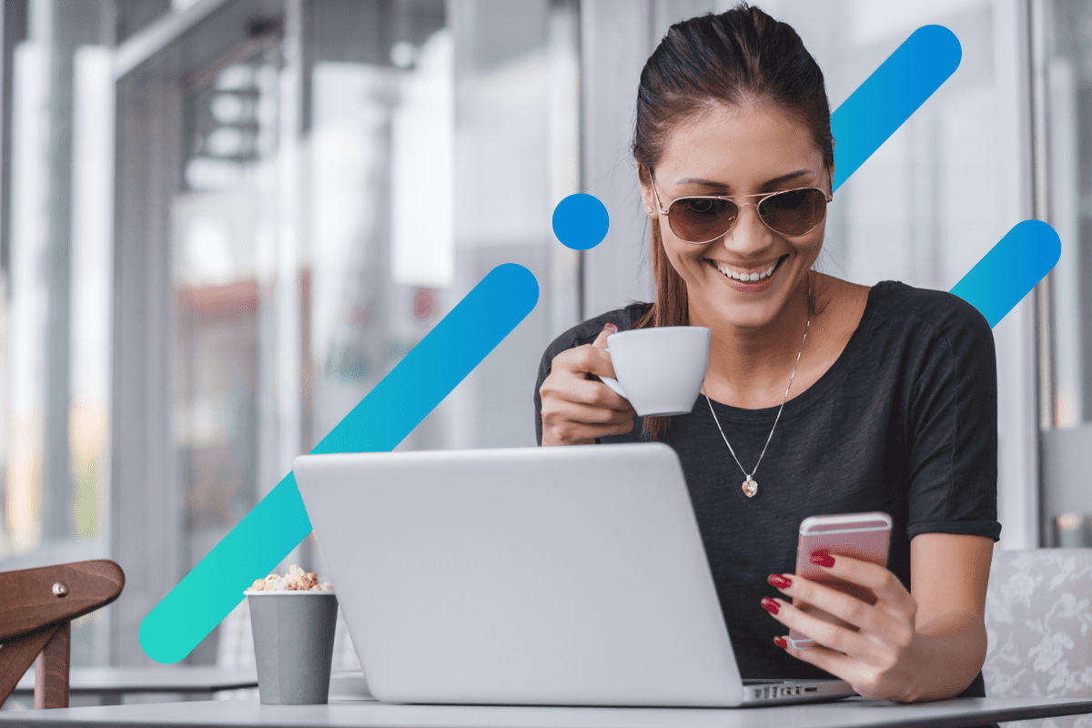 woman smiling holding coffee at a wifi cafe
