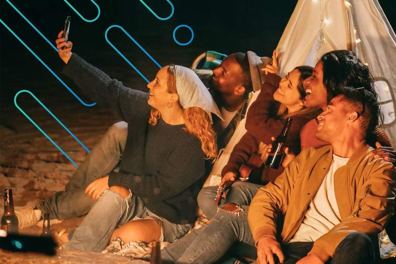 friends taking a selfie on the beach at night